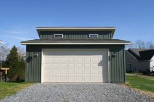 Green garage with wide white doors