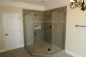Brown tile shower with glass panel