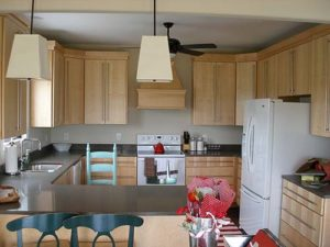 Wooden cabinets inside of kitchen