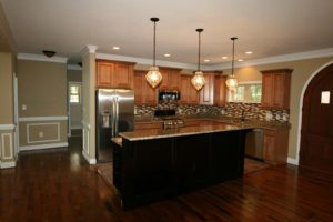 Brown kitchen with chandelier above