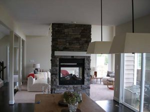 Brick wall mounted fireplace in the center of the living room