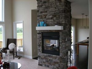 Dark brick wall mounted fireplace in the living room