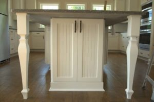 White cabinet below dining table