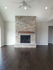 White brick wall mounted fireplace