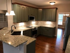 dark green hanging kitchen cabinets