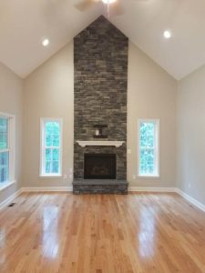 Brick wall mounted fireplace in the center of the room