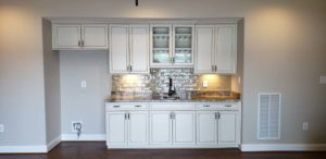 Wall mounted white kitchen cabinets