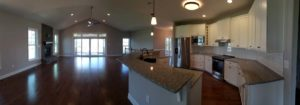 Panorama shot of kitchen and the living room