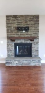 Brick wall mounted fireplace in an empty room