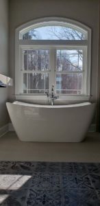 Round bathtub next to the window