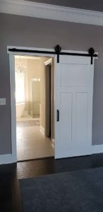 White wooden sliding door to the bathroom