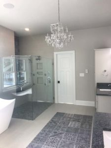 White bathroom with the chandelier