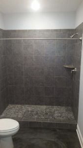 Shower with grey tiles in the bathroom