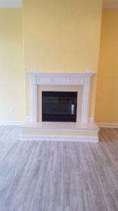 Wall mounted fireplace in an empty room