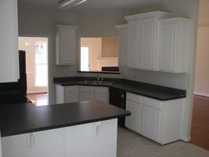 White sink cabinet with granite countertop