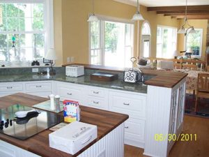 Multiple white cabinets in the center of the kitchen