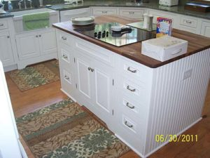 White cabinet in the center of the kitchen