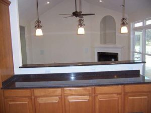 Wooden cabinets with granite countertop