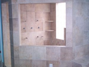 Light brown tiles inside of the shower