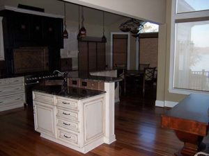 White kitchen cabinet with granite countertop