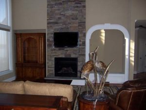Wall mounted fireplace with TV above in the living room