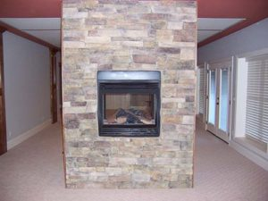 Wall mounted fireplace in the center of the room