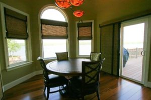 Round dinner table next to the windows