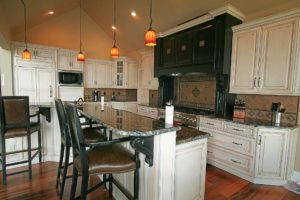 Wooden kitchen with marble countertops