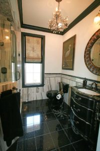 Bathroom with dark floor tiles and the sink