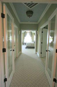 Empty hall leading to bedroom