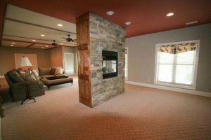 Fireplace in center of an empty room