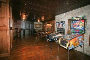 Two arcade machines next to the wall