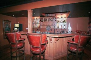 Wall mounted drinks cabinet behind bar